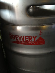 Brewery logo on the side of a keg.