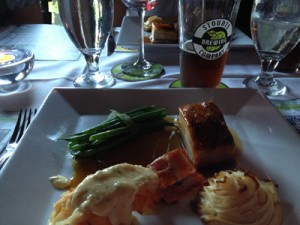Slow roasted pork belly and Scarlet Lady-poached lobster with Duchess Potatoes, paired with Scarlet Lady